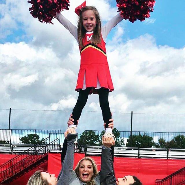 Daughter of Alumni Jess Homa Cheerleading outside of Maryland Stadium