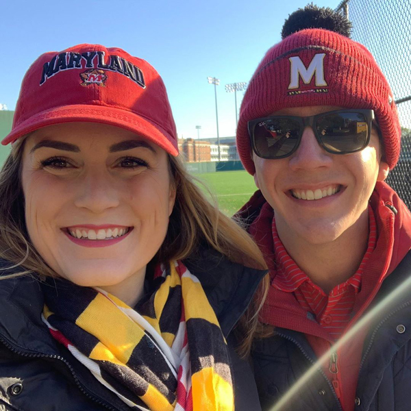 headshot of two adults, one wearing a umd branded baseball cap, the other wearing a umd branded beanie