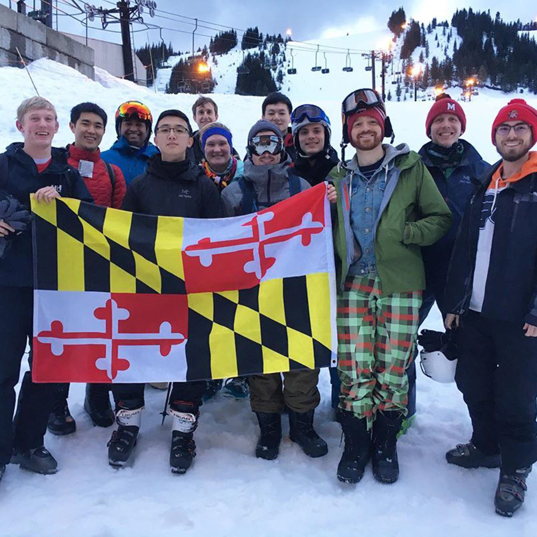 Seattle Terp Alumni Network Members posing with the Maryland Flag