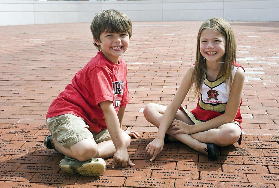 Kids of Alumni Association members on the Riggs Brick Rotunda