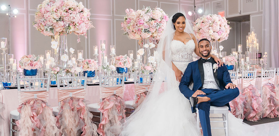 Dennis and siara pose at their wedding reception