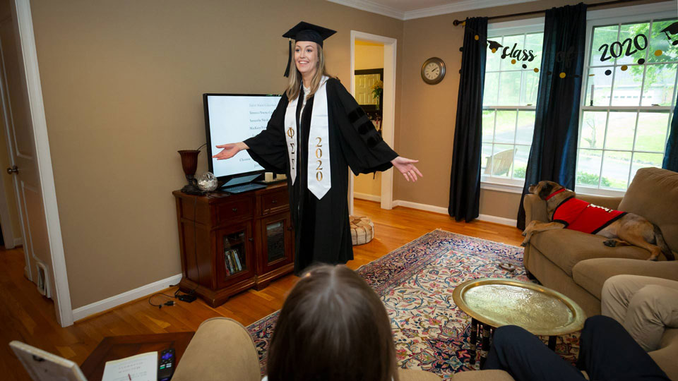 Student enjoying Winter Commencement at home