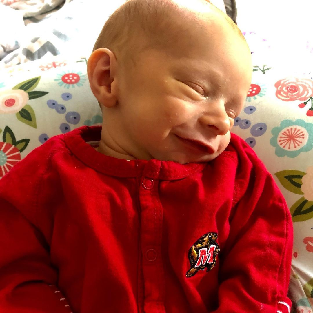 Danielle (Earls) Miller's Terp Baby wearing a red UMD onesie!