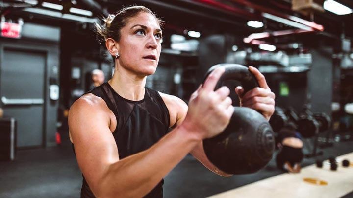 UMD alum Lauren Foundos in a fitness class
