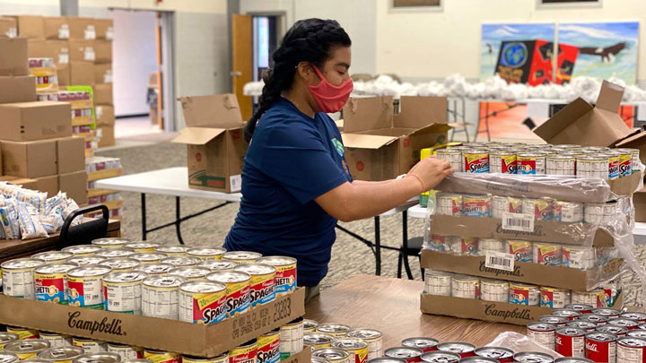 Tatiana Sandoval '19, prepares emergency food supplies for needy county residents at the Latin American Youth Center in Hyattsville