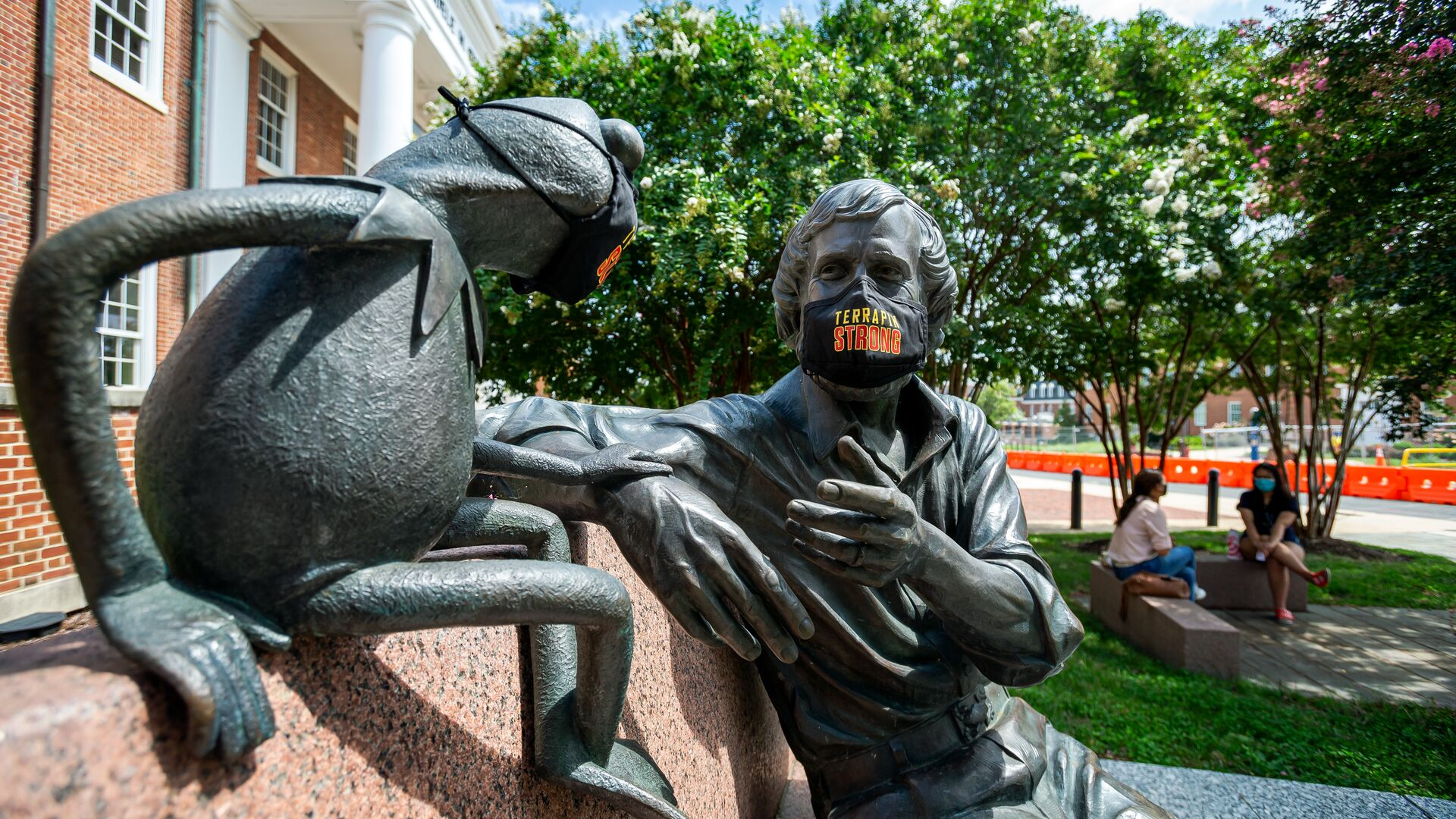 Jim Henson Statue and Memorial Garden in front of Stamp Student Union with the Terrapin Strong branded face mask.